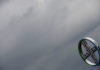 © Reuters. FILE PHOTO: A logo of Bayer is seen next to dark clouds at Cologne Bonn airport