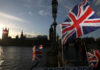 © Reuters. A stall sells Union flags in Westminster, London