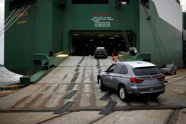© Bloomberg. Bayerische Motoren Werke AG (BMW) vehicles, assembled in the U.S., are driven onto the Wallenius Wilhelmsen Logistics AS Porgy vehicle carrier ship at the Port of Charleston in Charleston, South Carolina, U.S. Photographer: Luke Sharrett/Bloomberg