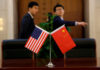 © Reuters. FILE PHOTO: Chinese and U.S. flags are set up for a signing ceremony during a visit by U.S. Secretary of Transportation Elaine Chao at China