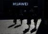 © Reuters. People walk past a Huawei shop in Beijing