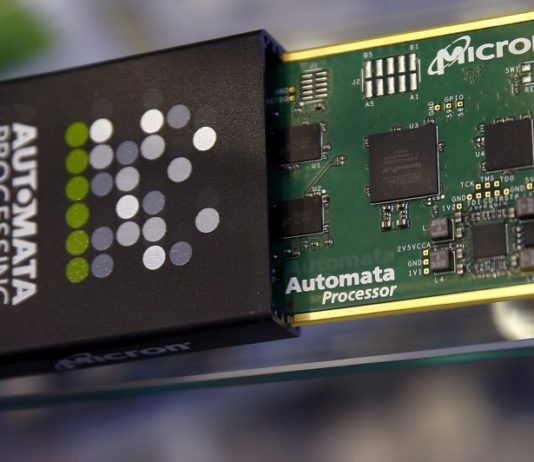 © Reuters. Memory chip parts of U.S. memory chip maker MicronTechnology are pictured at their booth at an industrial fair in Frankfurt