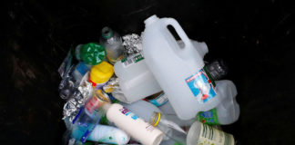 © Reuters. FILE PHOTO: Plastic bottles and containers are seen in a domestic recycling bin in Manchester