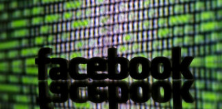 © Reuters. FILE PHOTO: A 3D printed Facebook logo is seen in front of displayed cyber code