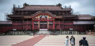 © Bloomberg. Tourists at Shuri Castle in Naha, Okinawa. Photographer: Carl Court/Getty Images