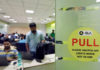 © Reuters. Employees work inside the office of Ola cab service in Gurugram