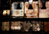 © Reuters. FILE PHOTO: Pound Sterling notes and change are seen inside a cash resgister in a coffee shop in Manchester