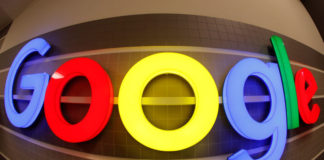 © Reuters. An illuminated Google logo is seen inside an office building in Zurich