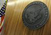 © Reuters. FILE PHOTO: The seal of the U.S. Securities and Exchange Commission hangs on the wall at SEC headquarters in Washington, June 24, 2011.