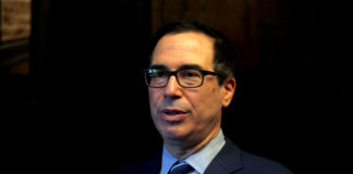 © Reuters. FILE PHOTO: U.S. Treasury Secretary Mnuchin speaks during his interview with Reuters in Jerusalem