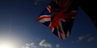 © Reuters. A union flag is seen for sale at a kiosk on Westminster Bridge opposite the Houses of Parliament in London