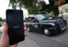 © Reuters. The Uber application is seen on a mobile phone in London