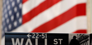 © Reuters. FILE PHOTO: Wall St. sign is seen outside NYSE in New York