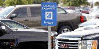 © Reuters. Sign indicating parking for GM cars is seen at the General Motors Assembly Plant in Arlington, Texas