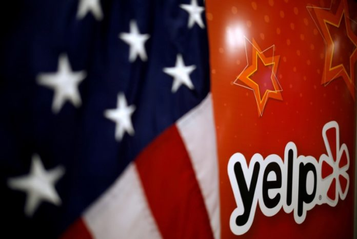© Reuters. FILE PHOTO: The Yelp Inc. logo is seen in their offices in Chicago, Illinois