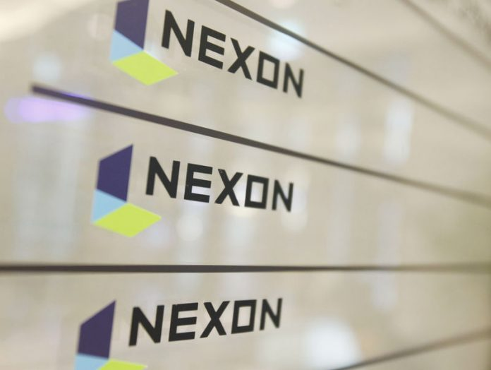 © Reuters. FILE PHOTO:  Logos of Nexon are seen at its main office building in Seoul