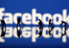 © Reuters. Figurines are seen in front of the Facebook logo in this illustration