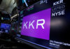 © Reuters. Trading information for KKR & Co is displayed on a screen on the floor of the NYSE in New York