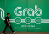 © Reuters. FILE PHOTO: A man walks past a Grab office in Singapore