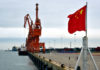 © Reuters. A Chinese national flag is seen at a port in Beihai