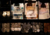 © Reuters. Pound Sterling notes and change are seen inside a cash resgister in a coffee shop in Manchester