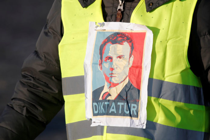 © Reuters. A man wearing a yellow vest, a symbol of a French drivers