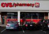 © Reuters. FILE PHOTO: Shoppers walk outside a CVS store and pharmacy in Medford