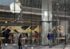 © Reuters. A man walks out of an Apple store in Beijing