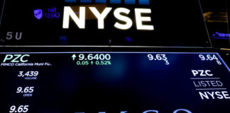 © Reuters. Ticker and trading information for PIMCO are displayed on a screen at NYSE in New York