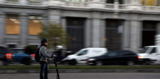 © Reuters. A man rides an electric scooter in Madrid