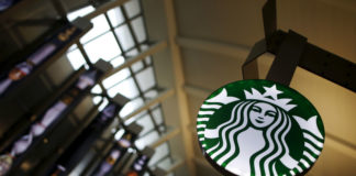 © Reuters. FILE PHOTO: A Starbucks store is seen inside the Tom Bradley terminal at LAX airport in Los Angeles