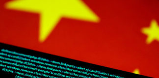 © Reuters. Illustration photo of computer code on a screen above a Chinese flag
